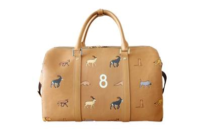 33d70f4441fc Customise Very Troubled Child s Savanna Bag with initials and lucky  numbers. The design is inspired by the luggage the brothers carry in Wes  Anderson s film ...