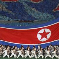 Members of the military marching at the Arirang Games