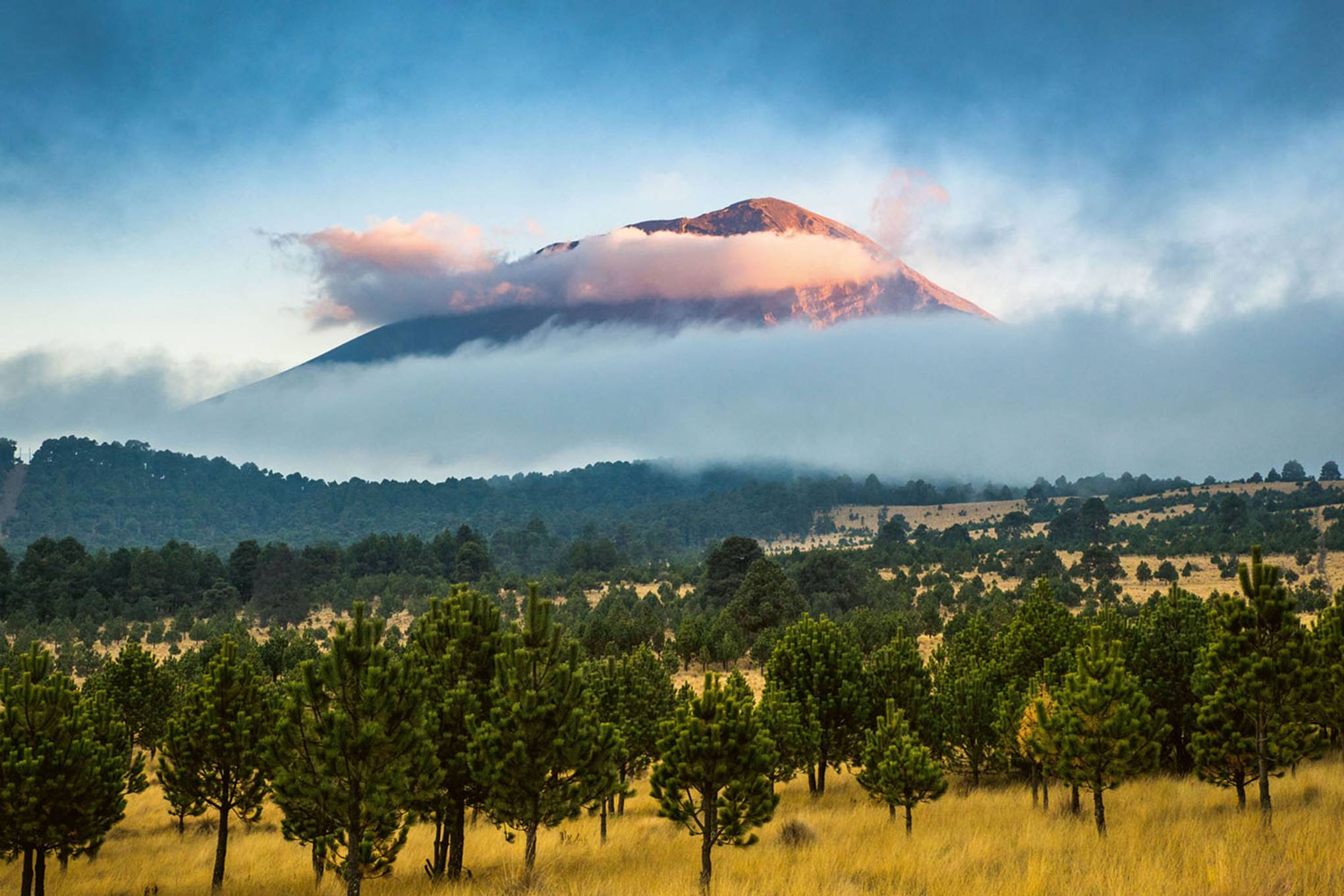 Extraordinary photos of the tallest volcano on every continent