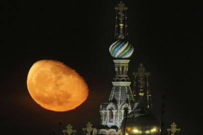 The Moon rises above St. Petersburg, Russia