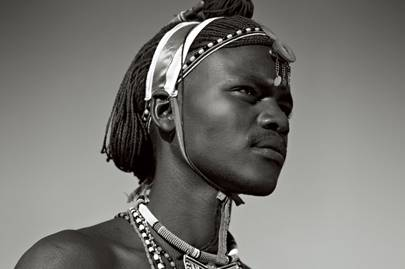 A Masai wearing a traditional necklace and headdress
